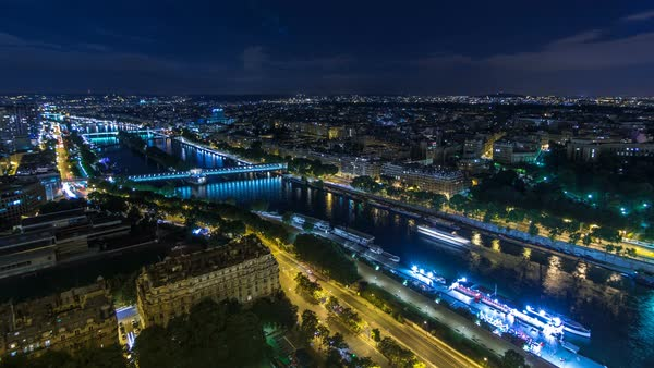 Aerial Night timelapse view of Paris City and Seine river shot on the top of Eiffel Tower observation deck. Evening illumination. Royalty-free stock video