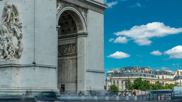 The Arc de Triomphe (Triumphal Arch of the Star) timelapse is one of the most famous monuments in Paris, standing at the western end of the Champs-Elyseees. Traffic on circle road. Blue cloudy sky at summer day Royalty-free stock video