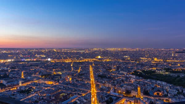 Panorama of Paris after sunset day to night transition timelapse. Top view from observation deck of montparnasse building in Paris - France. Colorful sky at summer day Royalty-free stock video