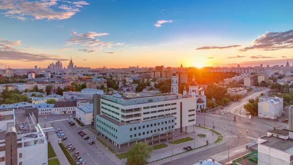 Aerial panorama of Moscow at sunset timelapse from rooftop. Skyscrapers, Kremlin towers and churches, stalin houses on background at evening in Moscow, Russia. Traffic on the road Royalty-free stock video