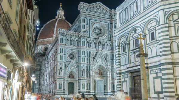 The front of The Basilica di Santa Maria del Fiore night timelapse which is the cathedral church (Duomo) of Florence in Italy. Evening illumination. Bell tower and dome Royalty-free stock video