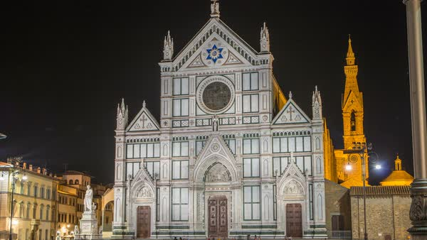 Tourists on Piazza di Santa Croce at night timelapse with Basilica di Santa Croce (Basilica of the Holy Cross) in Florence city. The church is burial place of famous Italians. Royalty-free stock video