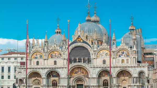 Basilica of St Mark timelapse. It is cathedral church of Roman Catholic Archdiocese of Venice. It lies at Piazza San Marco. Tourists walking in front of it. First St Mark's was constructed in 828. Venice, Italy Royalty-free stock video