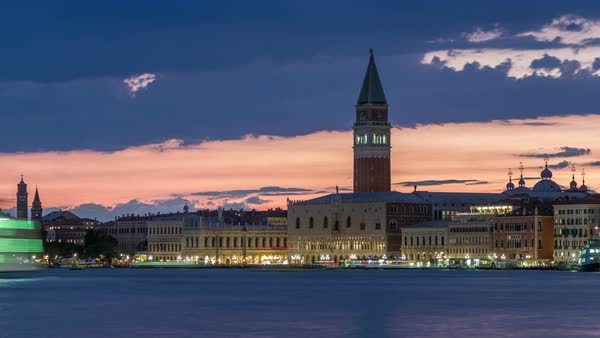 View of the Doge's Palace and the Campanile of St. Mark's Cathedral day to night transition timelapse. Venice, Italy. Colorful cloudy sky after sunset Royalty-free stock video