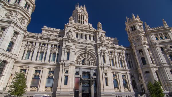 Cibeles Palace timelapse hyperlapse (Palacio de Cibeles): City Hall of Madrid (formerly Palace of Communication), cultural center and iconic monument of the city. Royalty-free stock video