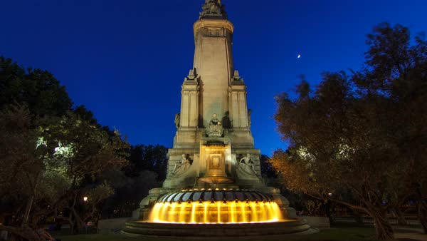 North-eastern side of the Cervantes monument timelapse hyperlapse on the Square of Spain (Plaza de Espana) in Madrid in summer time in Spain. Madrid is popular tourist destination of Europe. day to night transition Royalty-free stock video