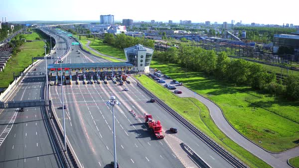Aerial view of highway with cars at modern toll road turnpike, entry fee pay gate. Royalty-free stock video