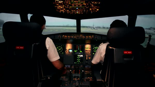 Pilot and co-pilot inside aircraft cockpit preparing for takeoff Royalty-free stock video