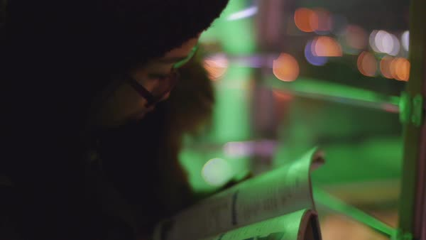 Hand-held shot of a woman reading a book Royalty-free stock video