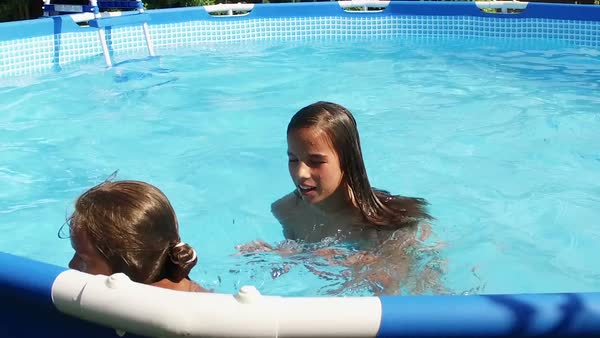 Two Cute Young Girls Taking A Selfie In A Swimming Pool -4281