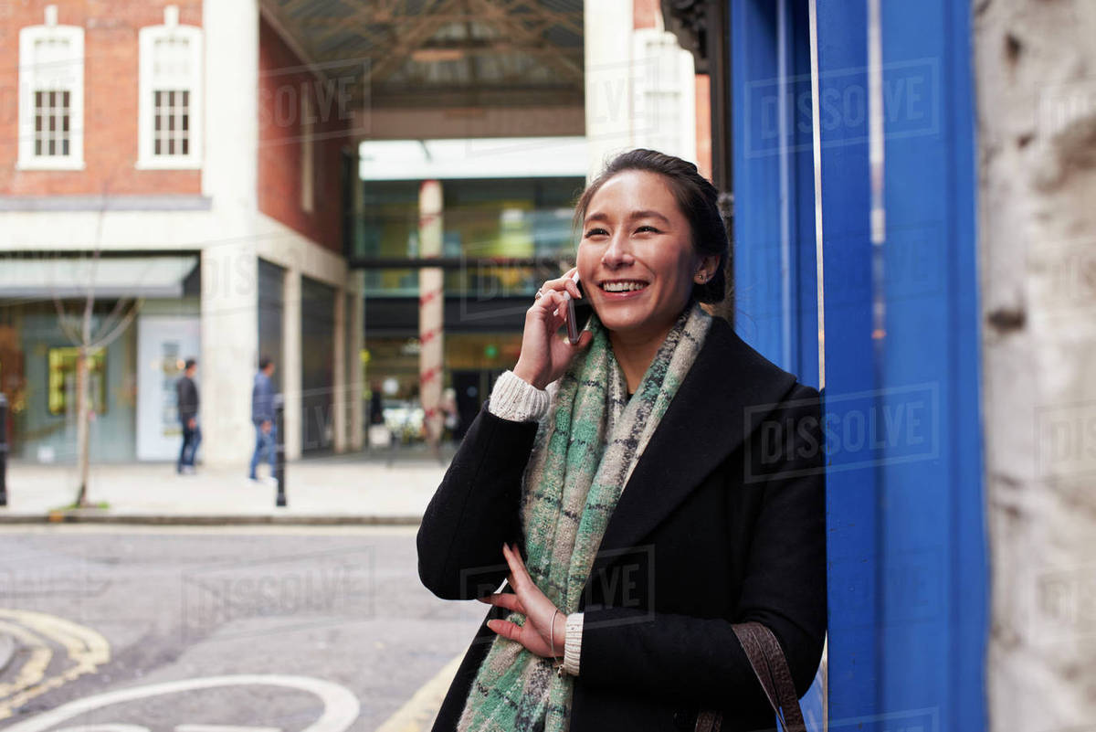 Young woman making phone call in city street Royalty-free stock photo