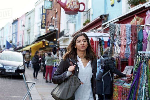 Mixed race young woman walking in Portobello Road market, London Royalty-free stock photo