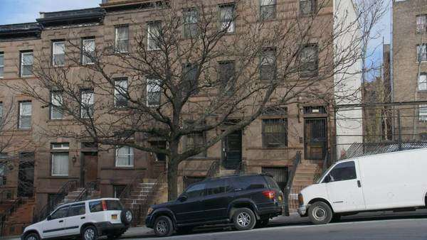 Static shot of townhouses in Harlem, New York City Rights-managed stock video