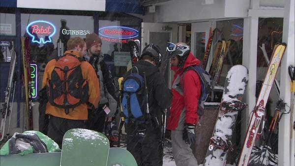 Hand-held shot of skiers standing in front of a bar Rights-managed stock video