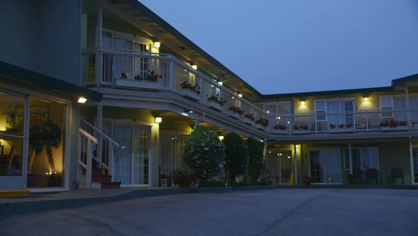 Static shot of guests arriving at a hotel in Santa Cruz Rights-managed stock video