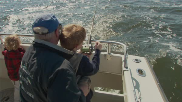 Montage of family fishing from a boat Rights-managed stock video