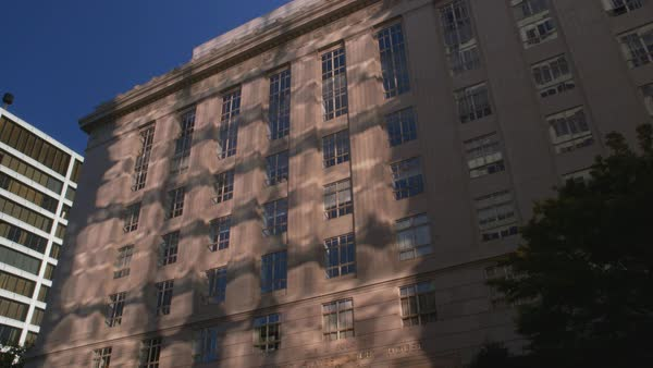Low-angle view of flickering reflections and shadows on a Portland building Rights-managed stock video
