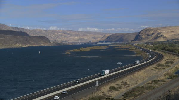 Establishing shot of a highway running along the Biggs junction on the Columbia river Rights-managed stock video