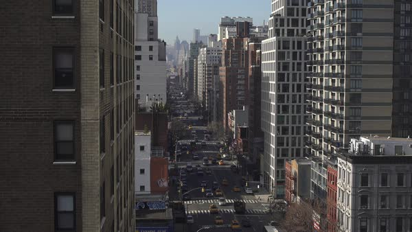 Static shot of traffic and apartment buildings on third avenue in New York City Rights-managed stock video