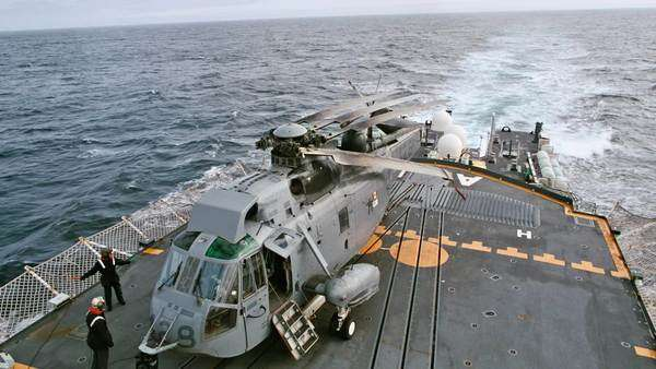 Helicopter on deck of navy vessel Rights-managed stock video
