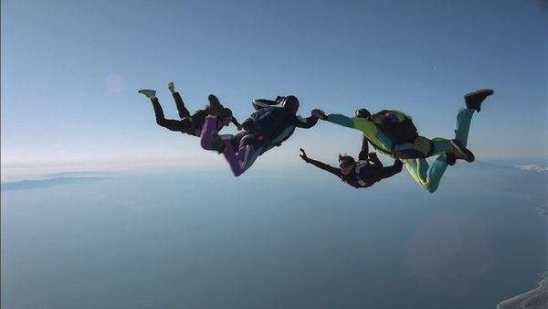 Skydiving team join hands Rights-managed stock video
