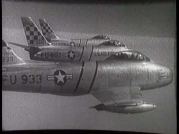 Montage of F-86 fighter jets flying in formation Rights-managed stock video