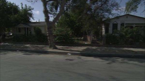 Homes in a low income neighborhood filmed from a moving car Rights-managed stock video