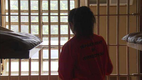Back view of a female prisoner in her cell Rights-managed stock video