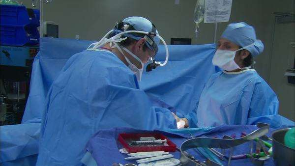 Panning shot view of a doctor and a nurse in operating room Rights-managed stock video