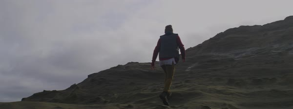 Slow motion shot of a man going up on a rocky hill Royalty-free stock video
