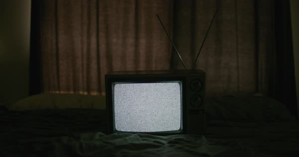 Medium shot of an old television on a bed at night - Stock Video Footage -  Dissolve
