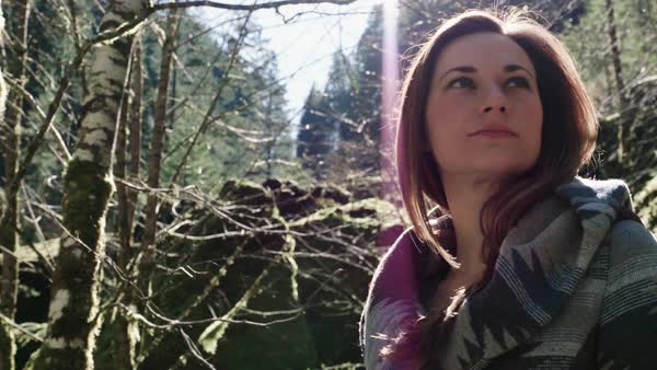 Medium close up shot of a woman standing in a forest Royalty-free stock video