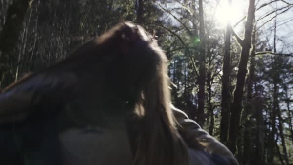 Medium shot of a woman walking in a forest Royalty-free stock video