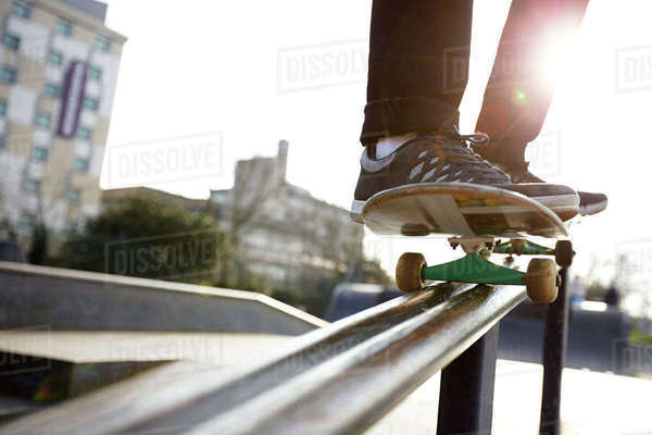 Close-up of skateboarder balancing on rail Royalty-free stock photo