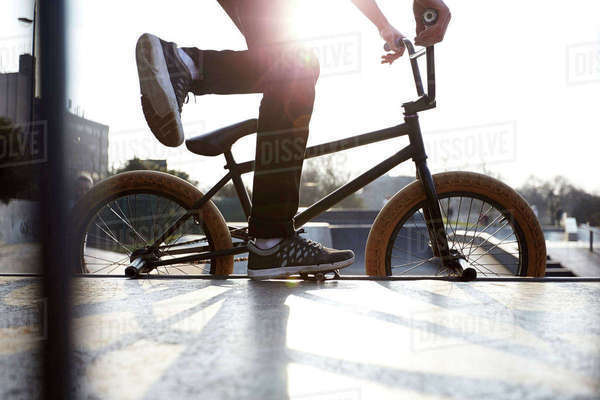Action shot of bmx rider in park Royalty-free stock photo