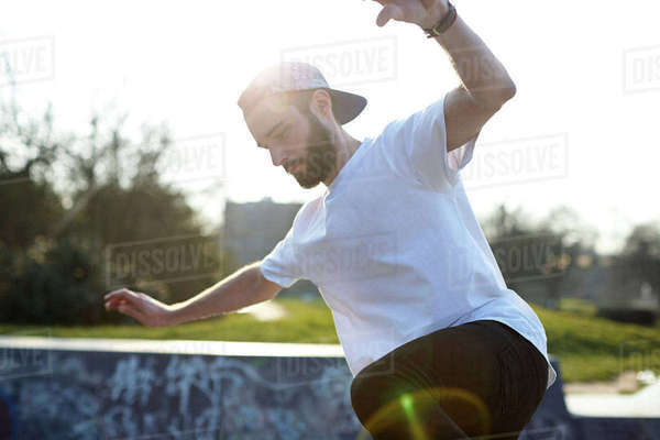 Action shot of skateboarder in park Royalty-free stock photo
