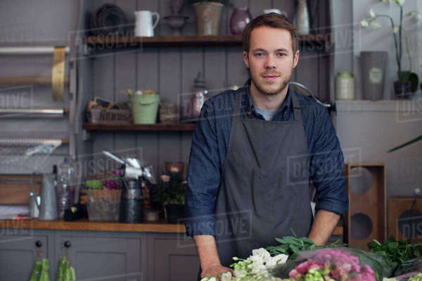 Portrait of male florist at work in shop Royalty-free stock photo