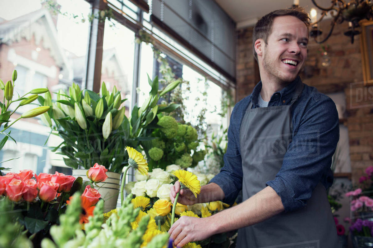 Male Florist At Work In Shop Stock Photo