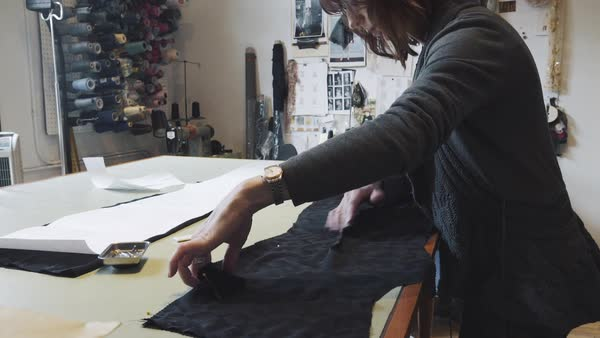Push-in shot of a designer making a dress Royalty-free stock video