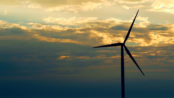 Lone wind turbine silhouetted in the light of the coming dawn. Royalty-free stock video