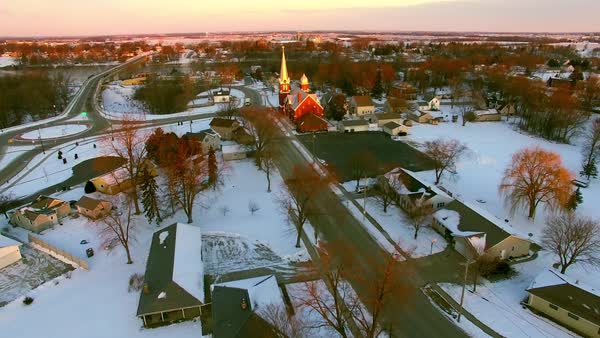 Beautiful Church steeple catches first light of daybreak in small town America. Royalty-free stock video