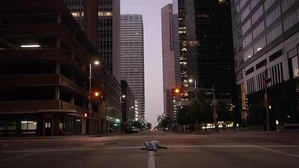Wide shot of a person lying on an empty road Royalty-free stock video