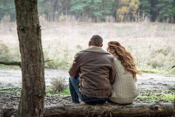 A young couple communing with nature on a forest walk in Autumn Royalty-free stock photo