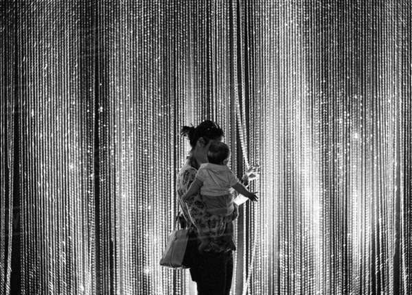 Mother and child at an exhibition with Svaronsky curtain in the background. Rights-managed stock photo