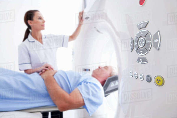 Technician nurse preparing patient for CT scan in hospital Royalty-free stock photo