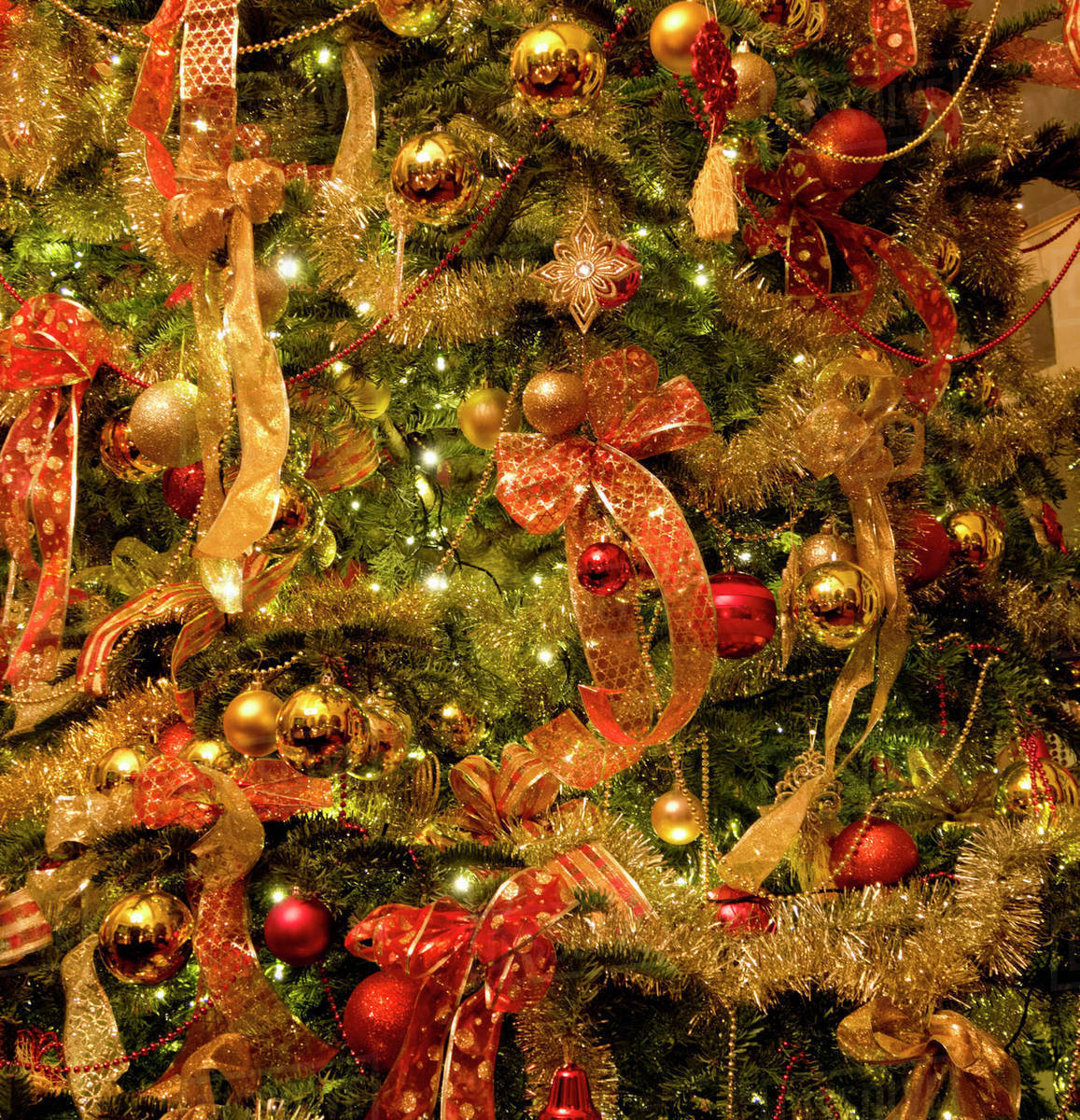 Full frame close up Christmas tree with ornaments and bow ...