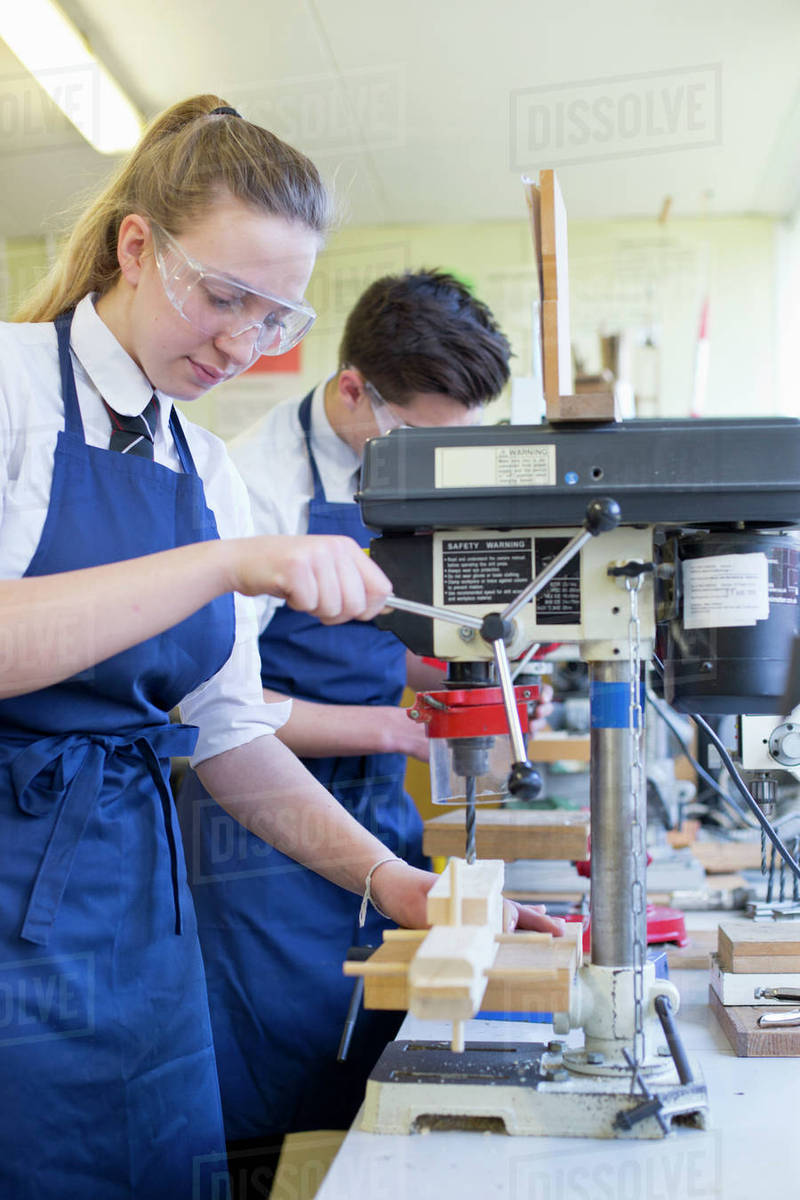 Female High School Student Using Drill In Woodworking Class D1230 21 178