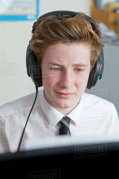 Close-up high school student with headphones listening to music Royalty-free stock photo