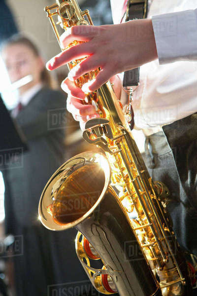 Close-up high school student playing saxophone in music class Royalty-free stock photo