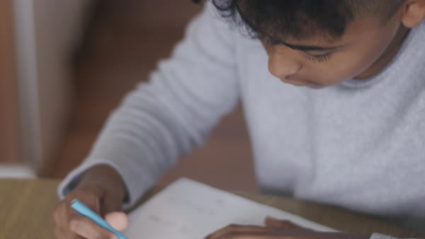 Hand-held shot of a boy doing his homework Royalty-free stock video